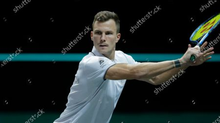 Stock Photo of Hungary's Marton Fucsovics plays a shot against Croatia's Borna Coric in their semifinal men's singles match of the ABN AMRO world tennis tournament at Ahoy Arena in Rotterdam, Netherlands