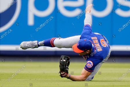 New York Mets center fielder Brandon Nimmo (9) catches a ball hit by Washington Nationals 'Trea Turner during the fifth inning of a spring training baseball game, in West Palm Beach, Fla