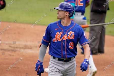 New York Mets' Brandon Nimmo (9) walks to the dugout after striking out during the third inning of a spring training baseball game against the Washington Nationals, in West Palm Beach, Fla