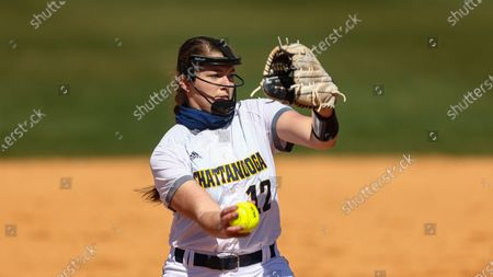Stock Image of Chattanooga's Hannah Wood throws to a batter during an NCAA college softball game, in Nashville, Tenn