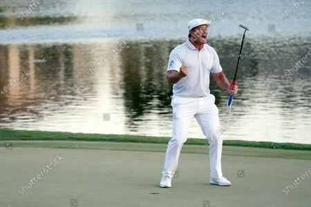 Bryson DeChambeau celebrates after sinking his final putt to win the Arnold Palmer Invitational golf tournament, in Orlando, Fla