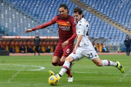 Stock Picture of Chris Smalling (L) of AS Roma and Mattia Destro (R) of CFC Genoa