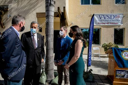 San Diego congressional representatives Scott Peters, Juan Vargas, Mike Levin and Sara Jacobs chat before a press conference where they rallied behind the American Rescue Plan at Veterans Village of San Diego