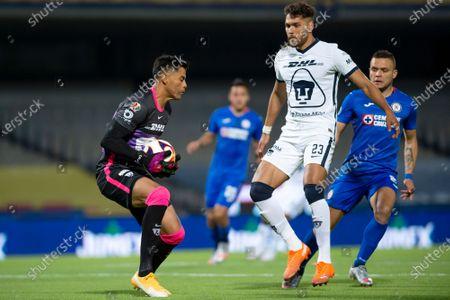 Alfredo Talavera #1, Nicolas Freire #23 of Pumas UNAM fights for the ball against Jonathan Rodriguez #21 of Cruz Azul