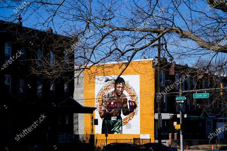 New Mural Arts Philadelphia painting honoring Joe Frazier on the 50th anniversary of the boxer's World Heavyweight championship bout against Muhammad Ali, in shown on the side of a building in Philadelphia