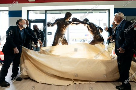 Statue of boxers Joe Frazier, center right, and Muhammad Ali, center left, is unveiled on the 50th anniversary their World Heavyweight Champion fight, at the Joe Hand Gym in Feasterville, Pa