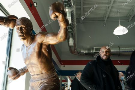 Joe Frazier Jr., looks at a statue of his father Joe Frazier, left, fighting Muhammad Ali, on the 50th anniversary of the boxers' World Heavyweight Championship boxing bout, at the Joe Hand Gym in Feasterville, Pa