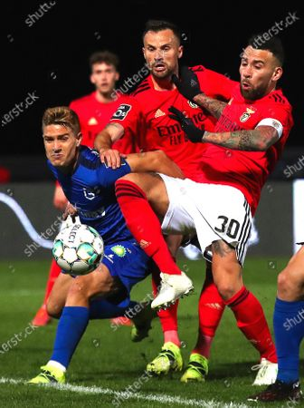 Belenenses' Tomas Ribeiro (L) in action against Benfica's Nicolas Otamendi (R) during the Portuguese First League soccer match between Belenenses and Benfica Lisbon at the National Stadium in Oeiras, near Lisbon, Portugal, 08 March 2021.