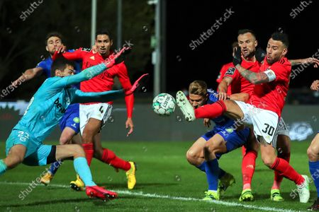 Belenenses' Tomas Ribeiro (3-R) in action against Benfica's Nicolas Otamendi (R) during the Portuguese First League soccer match between Belenenses and Benfica Lisbon at the National Stadium in Oeiras, near Lisbon, Portugal, 08 March 2021.