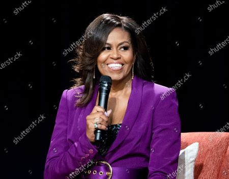 Stock Picture of Former first lady Michelle Obama speaks during an appearance in Atlanta. Obama and soccer star Mia Hamm are among those chosen for the 2021 National Women's Hall of Fame class announced . Former PepsiCo Chief Executive Indra Nooyi and retired Brig. Gen. Rebecca Halstead, the first female commanding general at the strategic level during combat in Iraq, are also included along with several other women. The Women's Hall of Fame induction ceremony is scheduled for Oct. 2, 2021