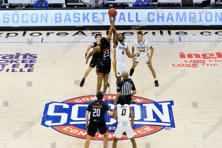 Mercer forward James Glisson III (23) and UNC-Greensboro forward Mohammed Abdulsalam (4) tip off for the start of an NCAA men's college basketball championship game for the Southern Conference tournament, in Asheville, N.C