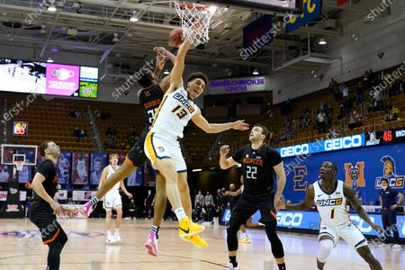 Stock Picture of UNC-Greensboro forward Angelo Allegri (13) collides with Mercer forward James Glisson III (23) under the basket as Mercer guard Neftali Alvarez (2), Mercer forward Felipe Haase (22) and UNC-Greensboro guard Isaiah Miller (1) look on in the second half of an NCAA men's college basketball championship game in the Southern Conference tournament, in Asheville, N.C