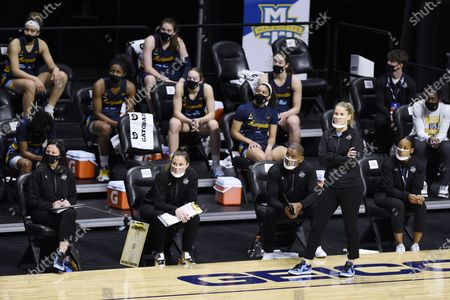 Marquette's Megan Duffy and her team watch the final seconds of an NCAA college basketball game against Connecticut in the Big East tournament finals at Mohegan Sun Arena, in Uncasville, Conn