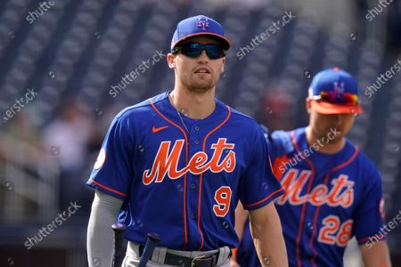 New York Mets center fielder Brandon Nimmo (9) walks off the field during a spring training baseball game against the Washington Nationals, in West Palm Beach, Fla