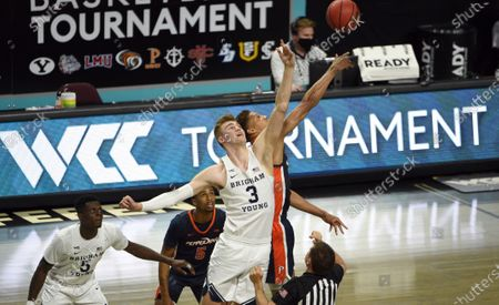 Forward Matt Haarms (3) and Pepperdine forward Kessler Edwards reach for the ball at the tippoff of an NCAA semifinal college basketball game at the West Coast Conference tournament, in Las Vegas