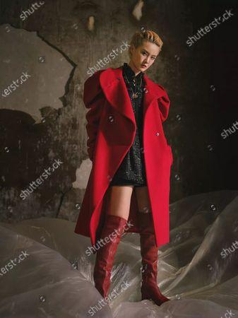 A model presents a creation by Shiatzy Chen during the Paris Fashion Week's Women Fall/Winter 2021-2022 ready-to-wear fashion digital show in Paris, France, on March 8, 2021.