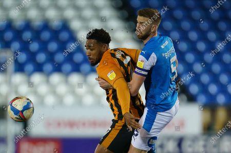Mallik Wilks of Hull City (7) and Mark Beevers of Peterborough United (5)