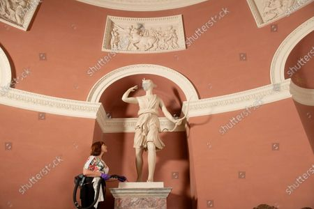 Collections and House officer, Lucy Cooper uses specialist equipment to clean the Pantheon. She is pictured with epic Diana statue inside the temple.   Herculean effort  A major spring clean is taking place at one of Britain's most famous temples as it prepares for the time when it can reopen. The Pantheon at Stourhead was designed by the architect Henry Flitcroft and built between 1753 and 1754.    It is loosely modelled on the Pantheon in Rome and was originally called the Temple of Hercules.  The limestone temple was commissioned by Henry Hoare II, known as 'Henry the Magnificent', an English banker and garden designer.  It contains statues of Hercules, Diana, Flora, Isis and St Susanna and Horace Walpole said in 1762 it had few rivals 'in magnificence, taste and beauty'.