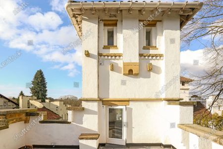 A quirky 116-year-old mini castle that has a tower roof terrace with far-reaching views is on the market for £925,000.  Grade II Listed High Morland Lodge is a five-storey Italianate property that has been sympathetically restored by its current owner.  The elaborate home in Knutsford, Cheshire, was originally built in 1905 as a gatehouse and designed by Richard Harding-Watt, who was a well-know designer in the area and lived in the same road as this property until 1913.  Most of the living space is spread over the three lower floors, with a roof terrace at the fourth storey and an office at the top to make the most of the impressive views.