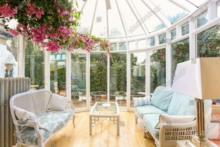 Stock Picture of A quirky 116-year-old mini castle that has a tower roof terrace with far-reaching views is on the market for £925,000.  Grade II Listed High Morland Lodge is a five-storey Italianate property that has been sympathetically restored by its current owner.  The elaborate home in Knutsford, Cheshire, was originally built in 1905 as a gatehouse and designed by Richard Harding-Watt, who was a well-know designer in the area and lived in the same road as this property until 1913.  Most of the living space is spread over the three lower floors, with a roof terrace at the fourth storey and an office at the top to make the most of the impressive views.