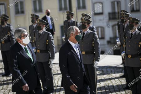Portuguese President Marcelo Rebelo de Sousa (C) accompanied by the President of the Parliament Eduardo Ferro Rodrigues (L) reviews the troops on parade at his arrival at Portuguese Parliament during his swearing ceremony for a second term as President of the Republic, in Lisbon, Portugal, 09 March 2021. Reelected in the 24 January presidential elections with 60.67 percent of the votes cast, the 72-year-old retired law professor, a former constituent deputy, will be sworn in on the original of the Constitution of the Portuguese Republic.