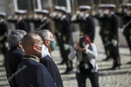 Portuguese President Marcelo Rebelo de Sousa (R) accompanied by the President of the Parliament Eduardo Ferro Rodrigues (L) reviews the troops on parade at his arrival at Portuguese Parliament during his swearing ceremony for a second term as President of the Republic, in Lisbon, Portugal, 09 March 2021. Reelected in the 24 January presidential elections with 60.67 percent of the votes cast, the 72-year-old retired law professor, a former constituent deputy, will be sworn in on the original of the Constitution of the Portuguese Republic.