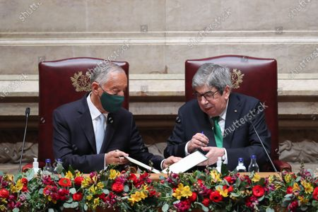 Portuguese President Marcelo Rebelo de Sousa (L) is sworn-in as Portuguese President next to Parliament President Eduardo Ferro Rodrigues (R) during the swearing ceremony at Portuguese Parliament in Lisbon, Portugal, 09 March 2021. Reelected in the 24 January presidential elections with 60.67 percent of the votes cast, the 72-year-old retired law professor, a former constituent deputy, will be sworn in on the original of the Constitution of the Portuguese Republic.