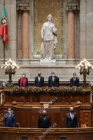 Marcelo Rebelo de Sousa (second row 2-L) accompanied by the Parliament President Eduardo Ferro Rodrigues (second row 2-R) and by the Prime Minister Antonio Costa (first row C) during his swearing ceremony at Portuguese Parliament in Lisbon, Portugal, 09 March 2021. Reelected in the 24 January presidential elections with 60.67 percent of the votes cast, the 72-year-old retired law professor, a former constituent deputy, will be sworn in on the original of the Constitution of the Portuguese Republic.