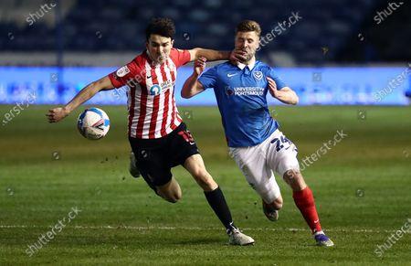 Luke O'Nien of Sunderland and Michael Jacobs of Portsmouth.