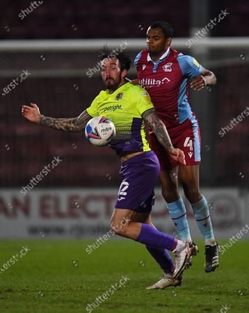 Ryan Bowman of Exeter City and Jacob Bedeau of Scunthorpe United