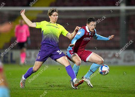 Alex Hartridge of Exeter City and Ryan Loft of Scunthorpe United