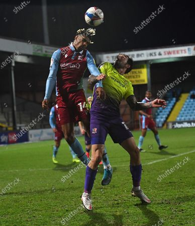 Devarn Green of Scunthorpe United and Ryan Bowman of Exeter City