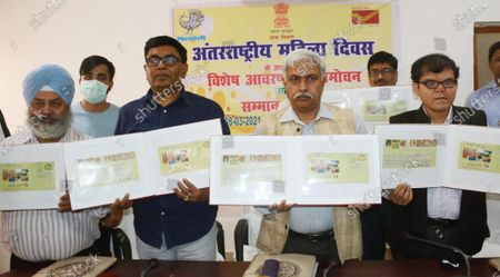Chief Post Master General Anil Kumar and others release a special cover on the occasion of International Women's Day at Patna GPO, on March 8, 2021 in Patna, India.