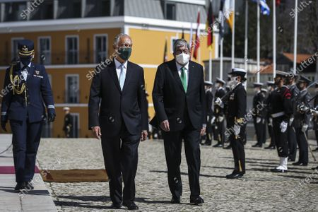 Stock Image of Portugal's President Marcelo Rebelo de Sousa (C) accompanied by Portuguese Parliament Eduardo Ferro Rodrigues (R) leaves the Parliament after his swearing in ceremony for a second term as President of the Republic, in Lisbon, Portugal, 09 March 2021. Reelected in the 24 January presidential elections with 60.67 percent of the votes cast, the 72-year-old retired law professor, a former constituent deputy, will be sworn in on the original of the Constitution of the Portuguese Republic.