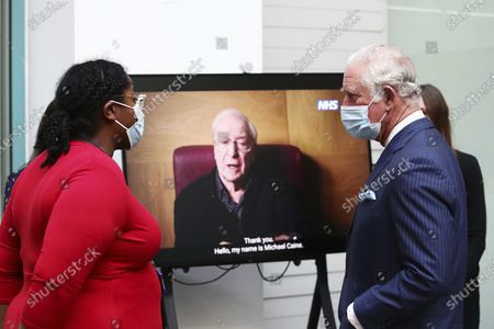 Stock Picture of Britain's Prince Charles watches a promotional video featuring actor Sir Michael Caine during a visit to Skipton House, London, where they are meeting NHS England and Ministry of Defence staff involved in the vaccine rollout