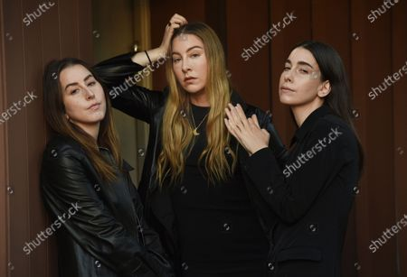 Sisters, from left, Alana, Este and Danielle Haim of the band HAIM pose for a portrait in Los Angeles on
