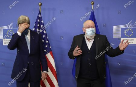 European Commissioner for European Green Deal Frans Timmermans, right, and U.S Special Presidential Envoy for Climate John Kerry address a media conference at EU headquarters in Brussels, . US special envoy for climate John Kerry traveled to Brussels Tuesday to discuss trans-Atlantic cooperation with European officials in the wake of President Joe Biden's decision to rejoin the global effort to curb climate change