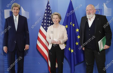 United States Special Presidential Envoy for Climate John Kerry, left, European Commission President Ursula von der Leyen, center, and European Commissioner for European Green Deal Frans Timmermans pose for photographers prior to a meeting at EU headquarters in Brussels, . US special envoy for climate John Kerry traveled to Brussels Tuesday to discuss trans-Atlantic cooperation with European officials in the wake of President Joe Biden's decision to rejoin the global effort to curb climate change