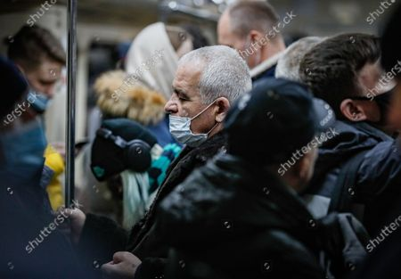 An elderly man wearing a protective face mask stands in Moscow's Metro during the pandemic of SARS-CoV-2 coronavirus in Moscow, Russia, 09 March 2021. Moscow's Mayor Sergei Sobyanin has canceled mandatory self-isolation for people over 65 and those with chronic diseases in Moscow. According to the official information, in the past 24 hours Russia registered 9445 included 1066 in Moscow new cases caused by the SARS-CoV-2 coronavirus infection.