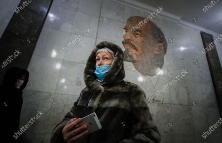 An elderly woman wearing a protective face mask walks in Moscow's Metro during the pandemic of SARS-CoV-2 coronavirus in Moscow, Russia, 09 March 2021. Moscow's Mayor Sergei Sobyanin has canceled mandatory self-isolation for people over 65 and those with chronic diseases in Moscow. According to the official information, in the past 24 hours Russia registered 9445 included 1066 in Moscow new cases caused by the SARS-CoV-2 coronavirus infection.