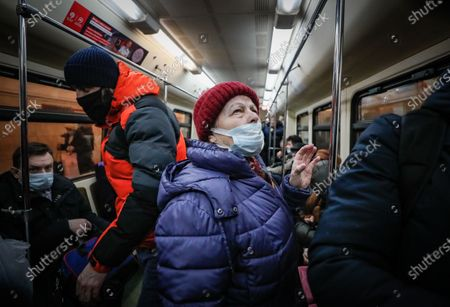 An elderly woman wearing a protective face mask stands in Moscow's Metro during the pandemic of SARS-CoV-2 coronavirus in Moscow, Russia, 09 March 2021. Moscow's Mayor Sergei Sobyanin has canceled mandatory self-isolation for people over 65 and those with chronic diseases in Moscow. According to the official information, in the past 24 hours Russia registered 9445 included 1066 in Moscow new cases caused by the SARS-CoV-2 coronavirus infection.