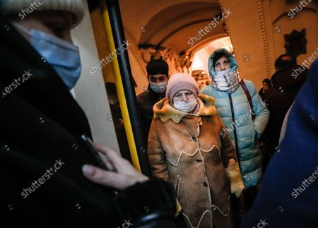 Russian people walk in Moscow's Metro during the pandemic of SARS-CoV-2 coronavirus in Moscow, Russia, 09 March 2021. Moscow's Mayor Sergei Sobyanin has canceled mandatory self-isolation for people over 65 and those with chronic diseases in Moscow. According to the official information, in the past 24 hours Russia registered 9445 included 1066 in Moscow new cases caused by the SARS-CoV-2 coronavirus infection.
