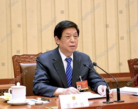 Li Zhanshu, an executive chairman of the presidium of the fourth session of the 13th National People's Congress (NPC), presides over the second meeting of the presidium at the Great Hall of the People in Beijing, capital of China, March 9, 2021.