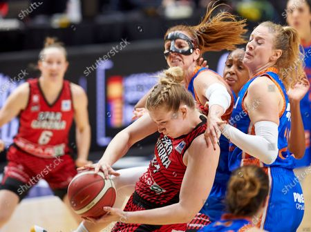 Stock Picture of Julia Reisingerová, Laura Gil, Marie Gülich and Celeste Trahan-Davis in action during the Queen´s Cup Final 2021 match between UNI Girona and Valencia Basket at Fonteta Stadium of Valencia.  (Final score: UNI Girona: 72 - Valencia Basket: 62)
