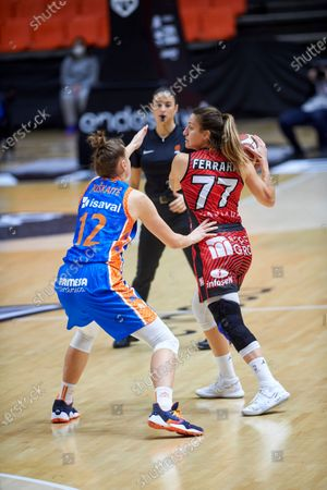 Stock Image of Paola Ferrari and Laura Juskaite in action during the Queen´s Cup Final 2021 match between UNI Girona and Valencia Basket at Fonteta Stadium of Valencia.  (Final score: UNI Girona: 72 - Valencia Basket: 62)