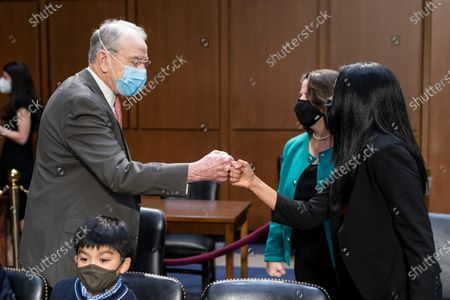 Sen. Chuck Grassley, R-Iowa, left, greets Vanita Gupta, right, before a Senate Judiciary Committee hearing to examine her nomination to be Associate Attorney General, with Lisa Monaco, second from right, before a hearing to examine her nomination to be Deputy Attorney General, on Capitol Hill, in Washington