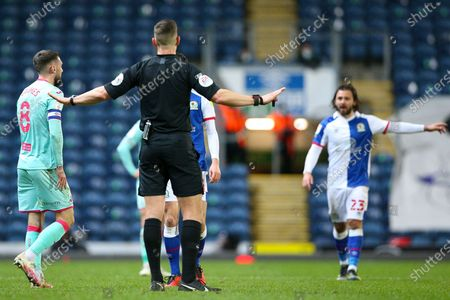 Referee Robert Jones tries to restore calm during the EFL Sky Bet Championship match between Blackburn Rovers and Swansea City at Ewood Park, Blackburn