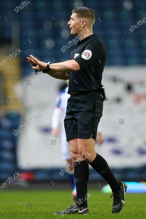 Referee Robert Jones during the EFL Sky Bet Championship match between Blackburn Rovers and Swansea City at Ewood Park, Blackburn