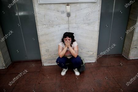 Cecilia Burgos cries outside the courtroom after a judge acquitted former Catholic Priest Carlos Eduardo Jose, citing the statute of limitations had run out on accusations of years of sexual abuse of Mailin Gobbo when she was an adolescent, in San Martin, Argentina, . Burgos alleges she was sexually abused by the 62-year-old as well