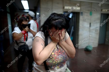 Stock Image of Cecilia Burgos cries outside the courtroom after a judge acquitted former Catholic Priest Carlos Eduardo Jose, citing the statute of limitations had run out on accusations of years of sexual abuse of Mailin Gobbo when she was an adolescent, in San Martin, Argentina, . Burgos says she was sexually abused by the 62-year-old as well